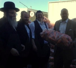 L to R: David Niederman of UJO, Jacob (Yanki) Itzkowitz Shomrim Coordinator, Sholom Deutsch, Brooklyn Borough President, Eric Adams Passover food distribution Brooklyn Navy Yard 4/7/14